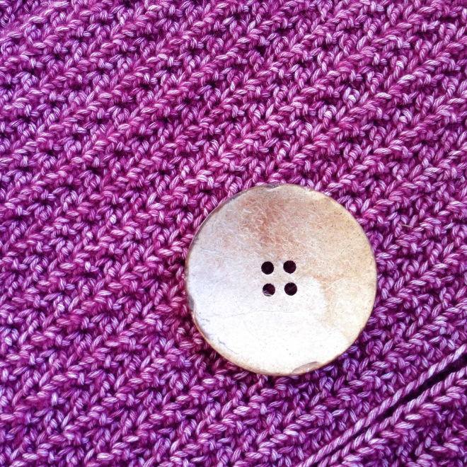 huge button and Stitch Detail on the vest, using Scheepjes Stone Washed in Garnet
