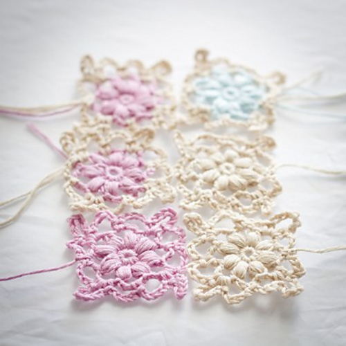 http://www.ravelry.com/patterns/library/crochet-puff-flower-motif
