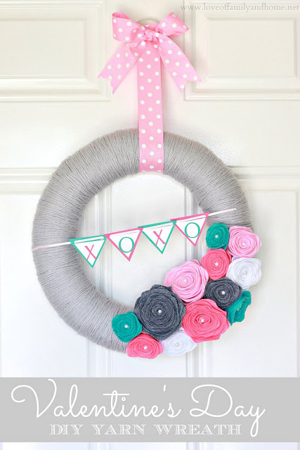 Valentine's Day DIY Yarn Wreath from Love of Family and Home: https://loveoffamilyandhome.net/2013/02/valentines-day-yarn-wreath-felt-rose-tutorial.html