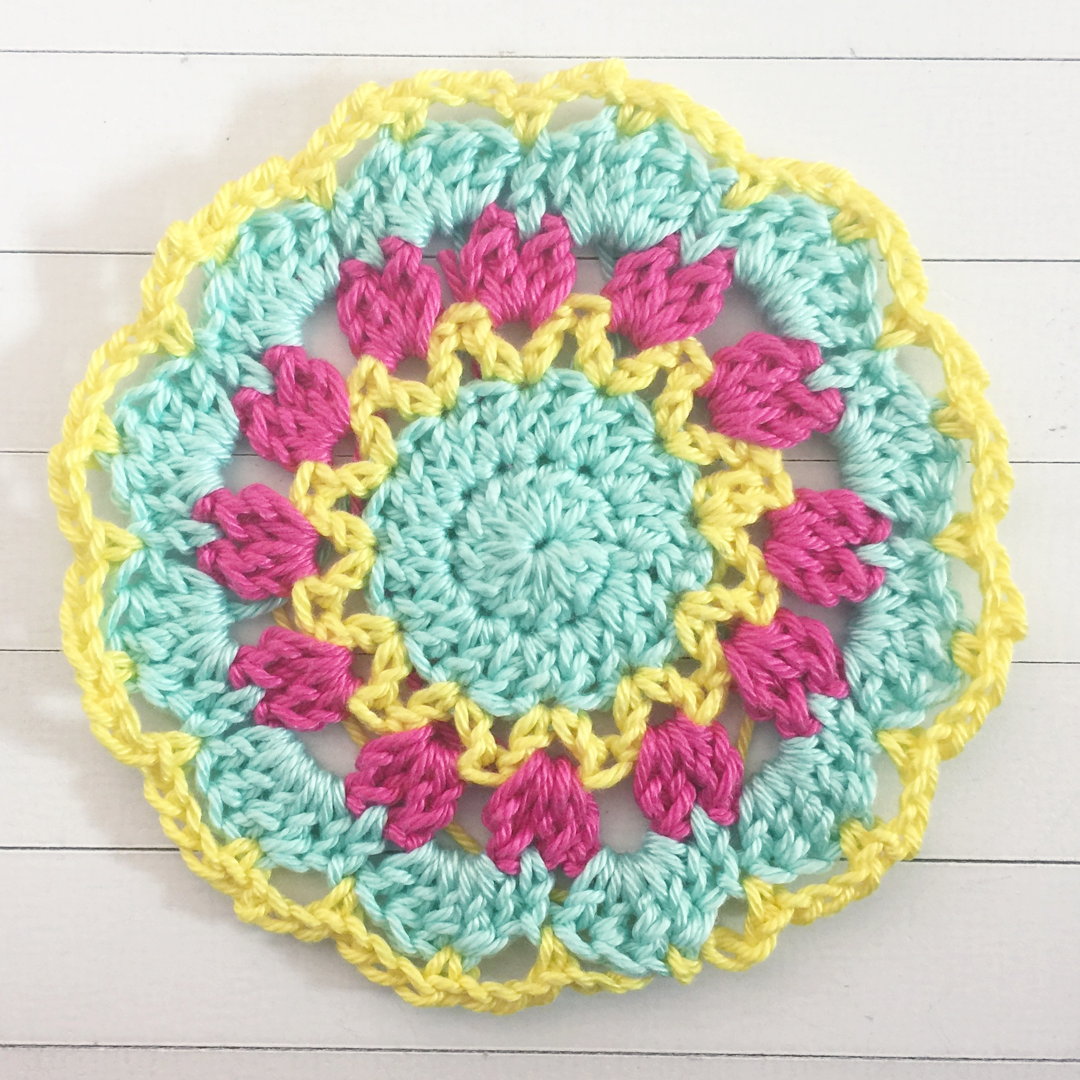 Join next colour to the top of any HDC with an SC (single crochet). CH3, sc into the Tr from the previous round. CH3, sc into the next HDC. Repeat this around, SS to join.