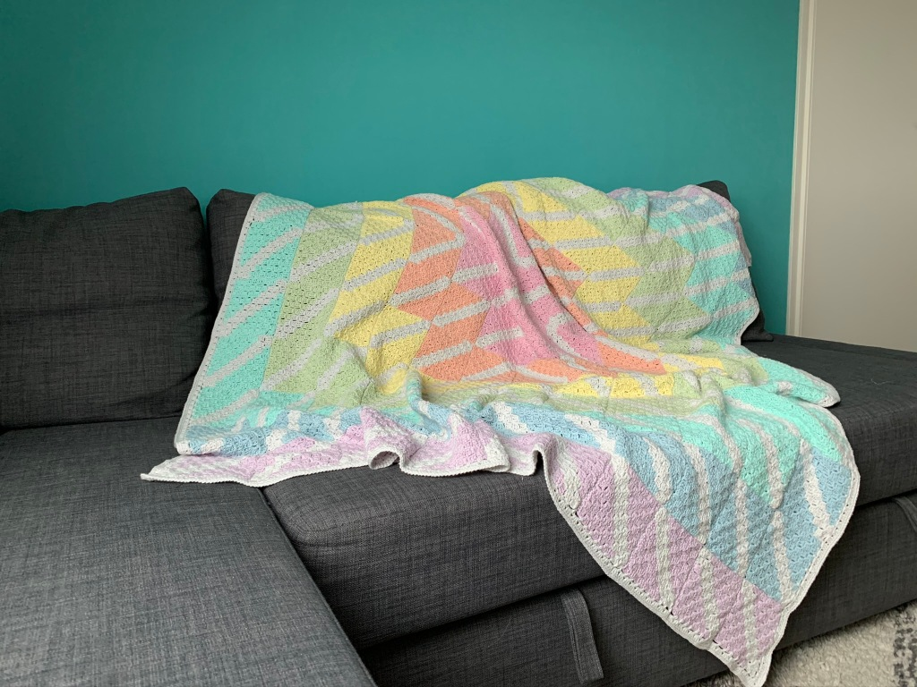 wide image of blanket draped over couch, to give an impression of size and appearance
