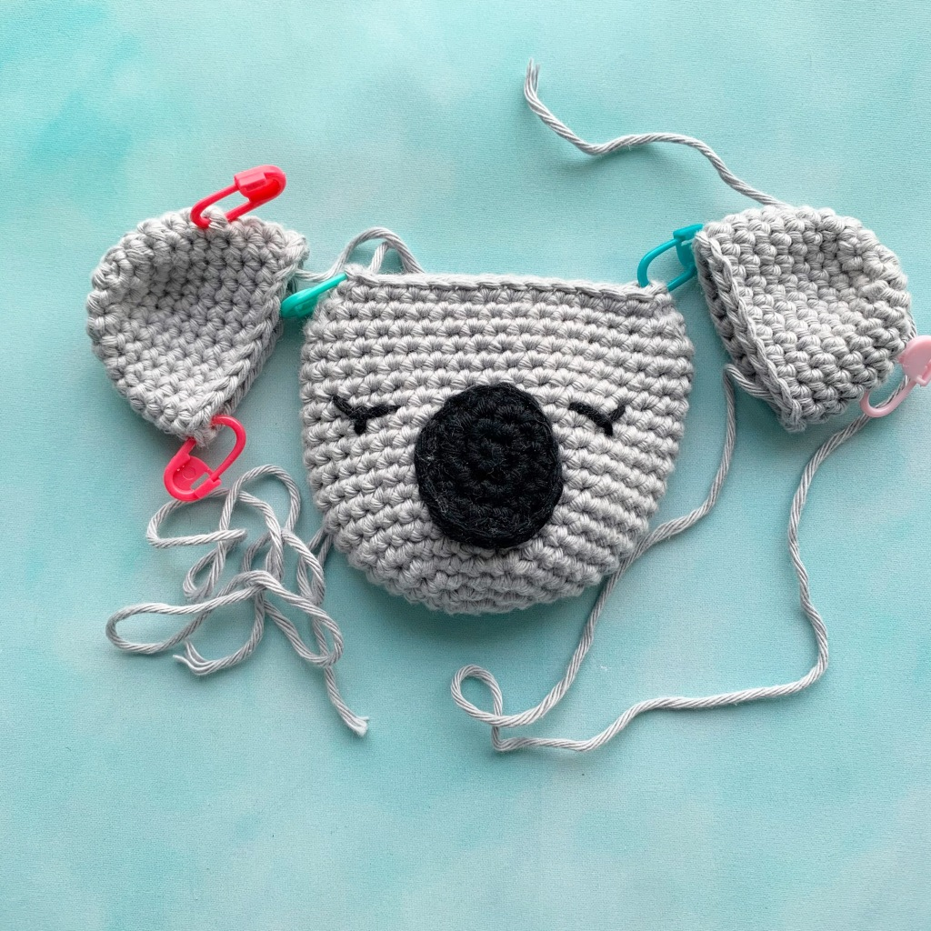 close up of crochet koala head in pieces