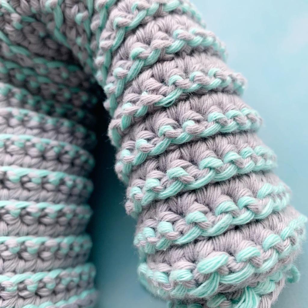 close up of crochet work, highlighing yarn under double crochet