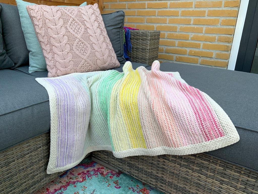styled shot of crochet blanket
