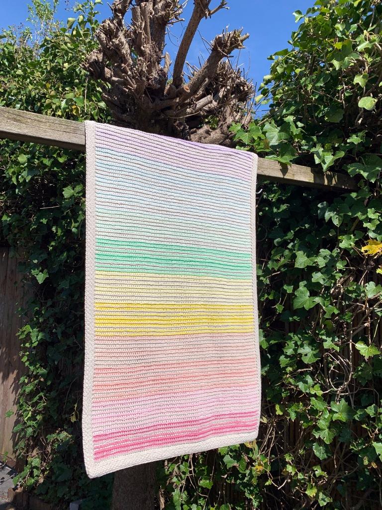 crochet blanket hanging in the sun